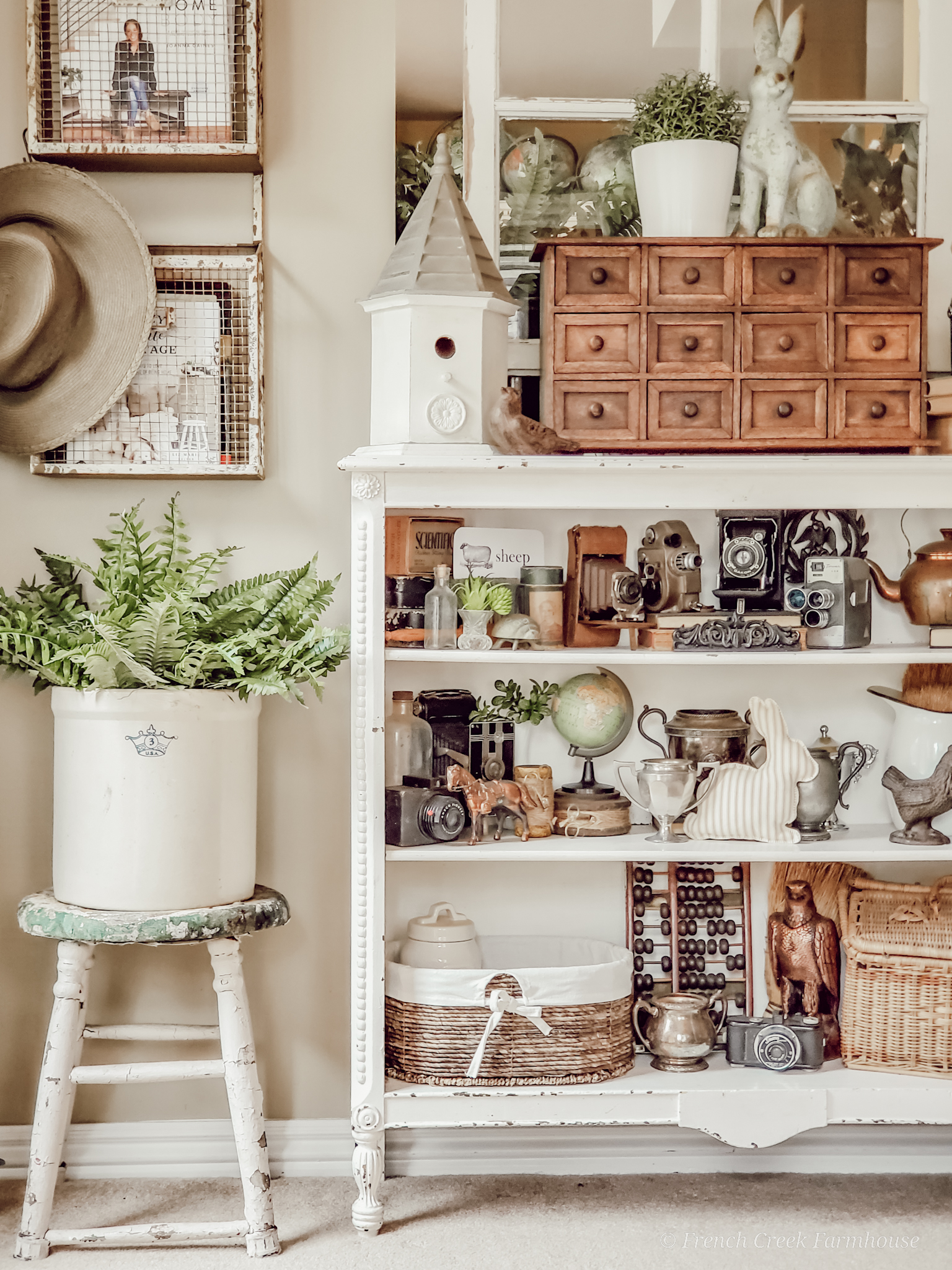 Vintage farmhouse shelves displaying antique finds