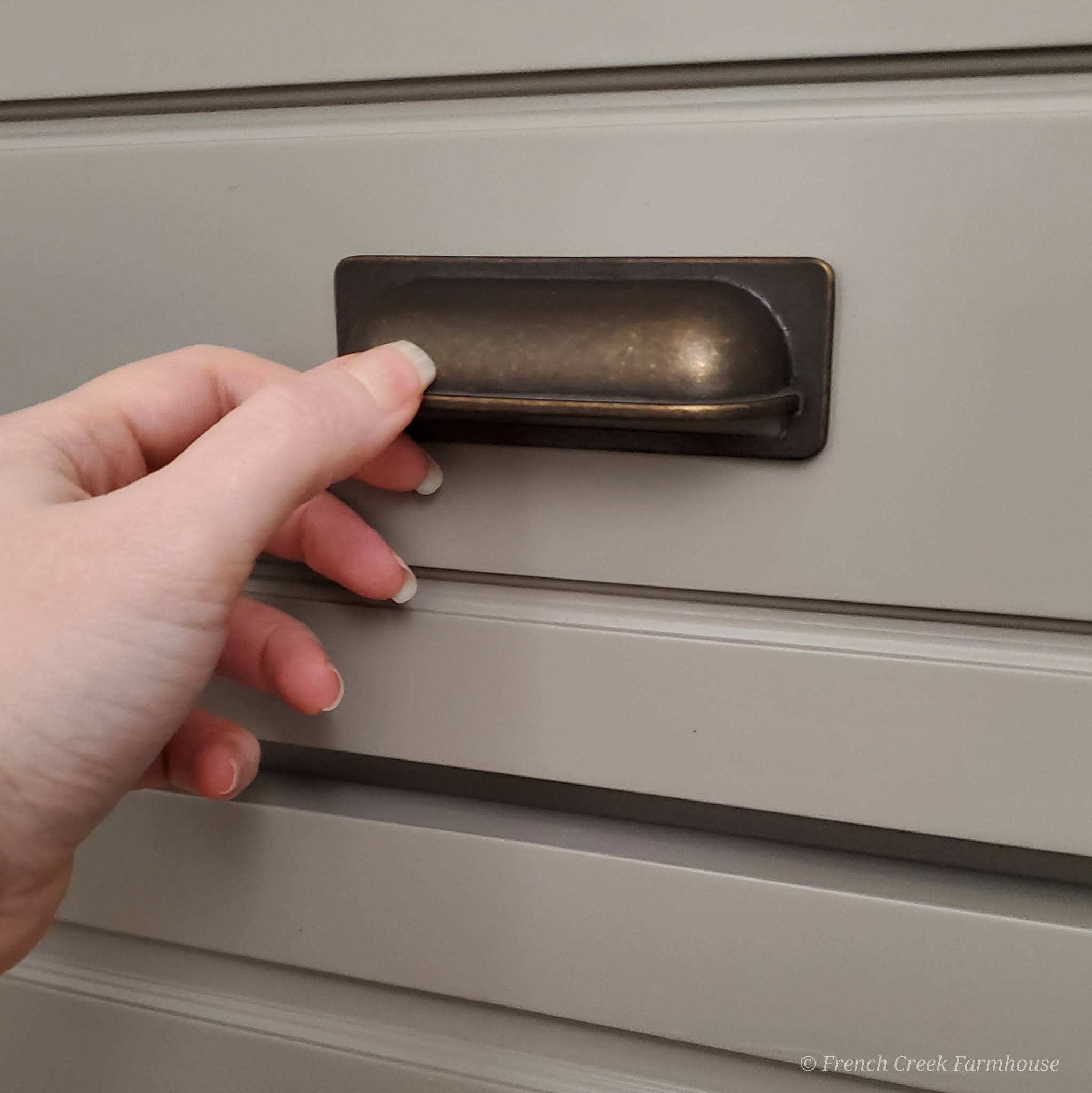 Adding cup pulls to the drawers gives a great French farmhouse feeling