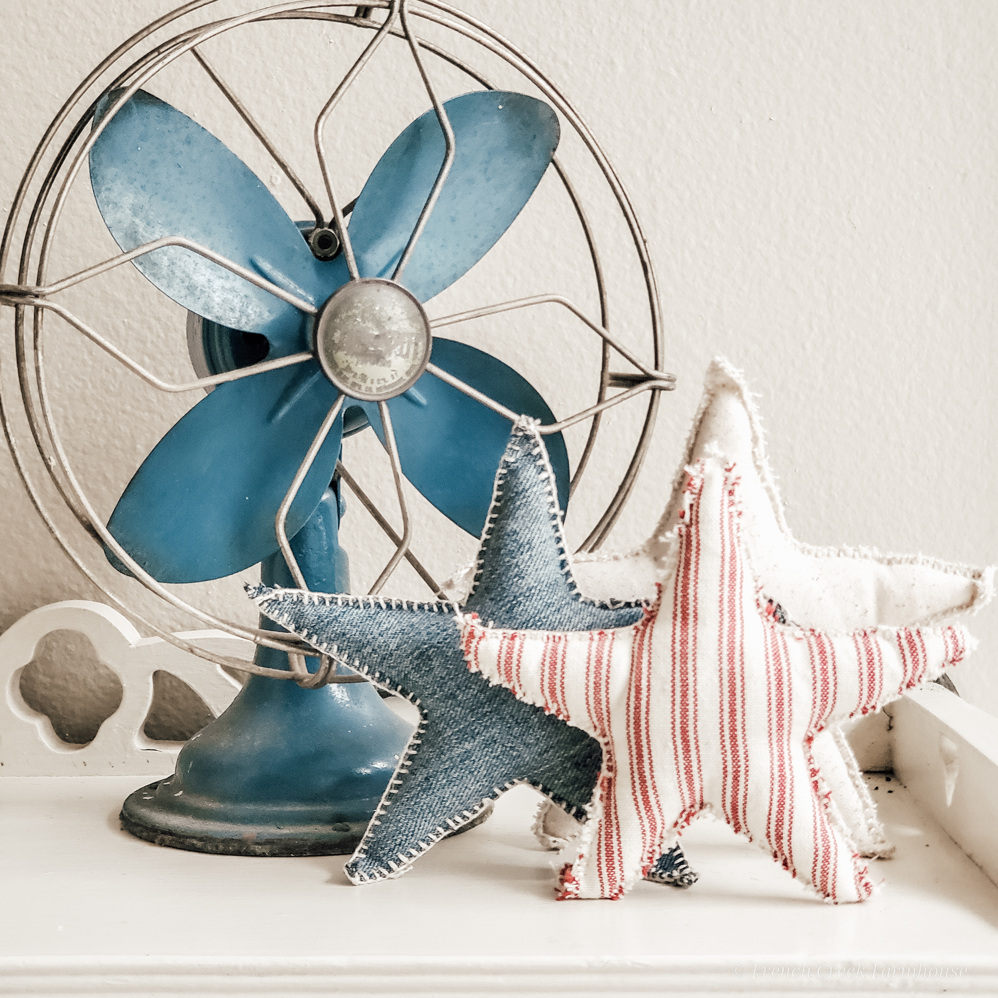 Vintage blue electric fan decorated for 4th of July