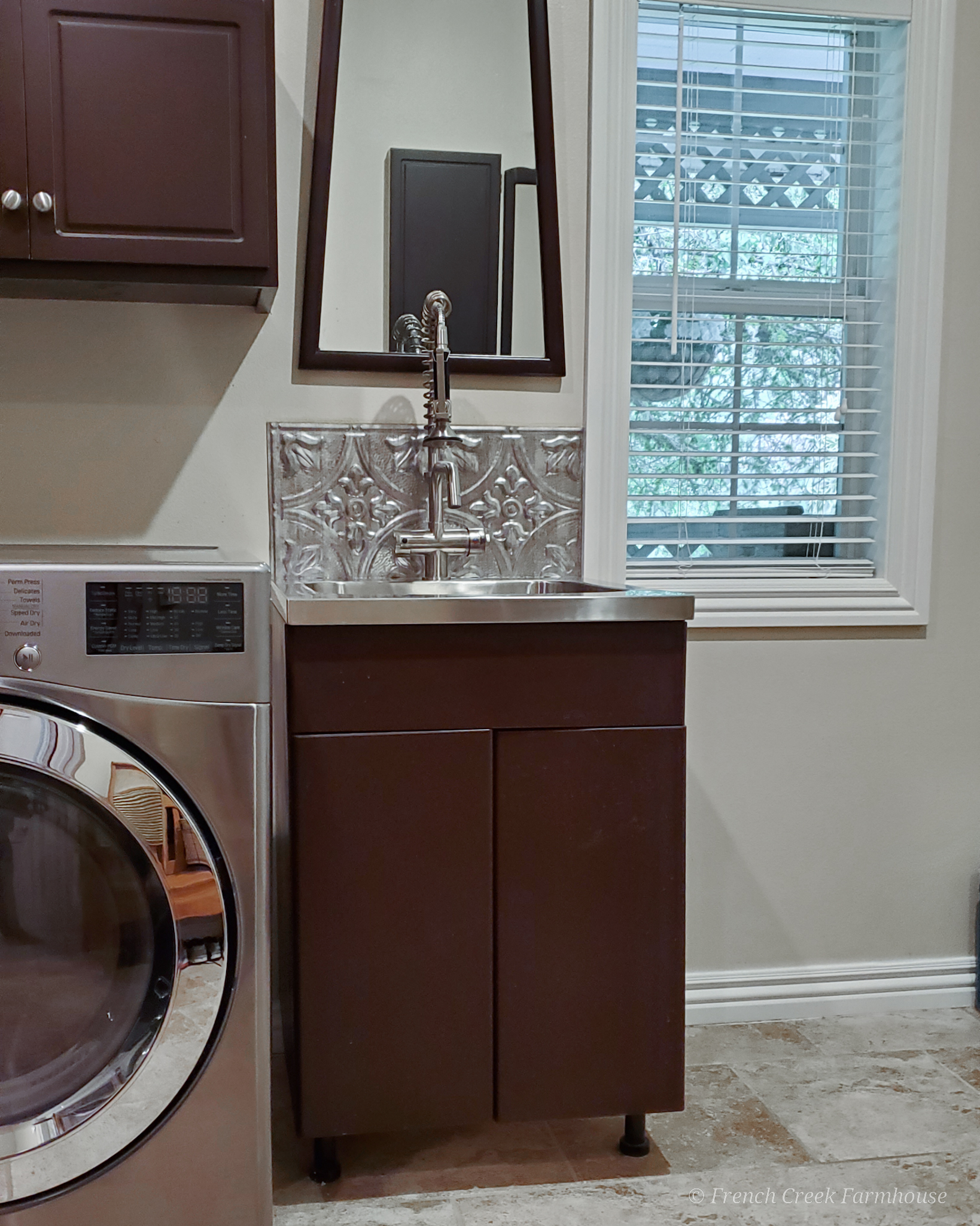 See the transformation of this builder grade utility sink cabinet!