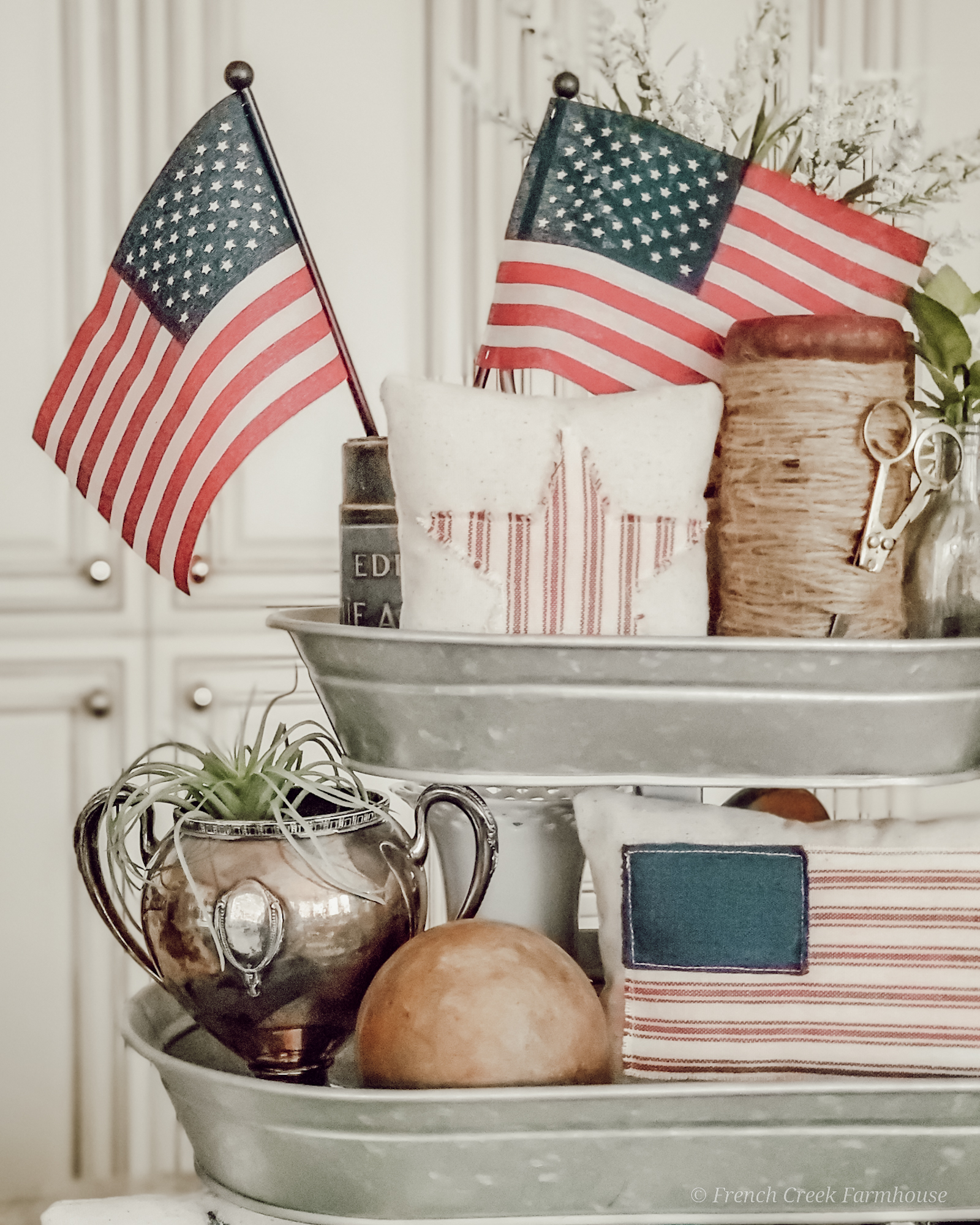 American flags top a tiered tray decorated for 4th of July
