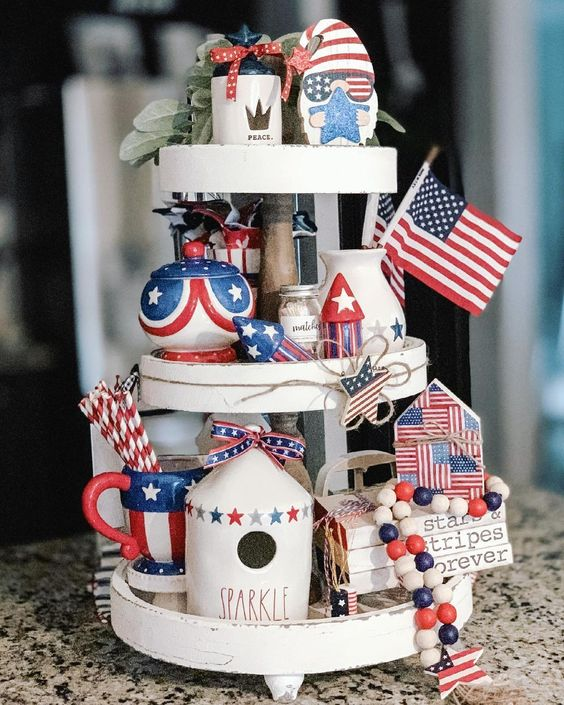 Red white and blue decor on a white 3-tier tray